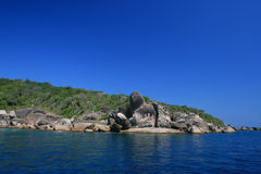 Blue sky over Similan Islands. The Similan Islands, West of Khao Lak in Thailand, are composed of nine uninhabited granite islands washed by a clear blue Stock Photos