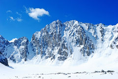 Blue sky over snowy white mountains Stock Image