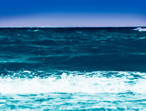 Blue sky over water Stock Image