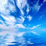 Blue sky over water. Background Royalty Free Stock Photo