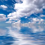 Blue sky over water Stock Photos