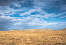Blue sky over wide open Wyoming prairie USA. Beautiful blue sky over wide open Wyoming prairie Stock Photo