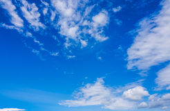 Blue sky overlay. Horizontal picture of clouds in the sky on a clear warm summer afternoon Stock Image