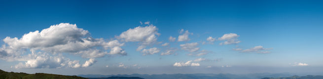 Blue sky panorama. Blue height sky above the mountains with some clouds. Four shots stitch image Stock Images