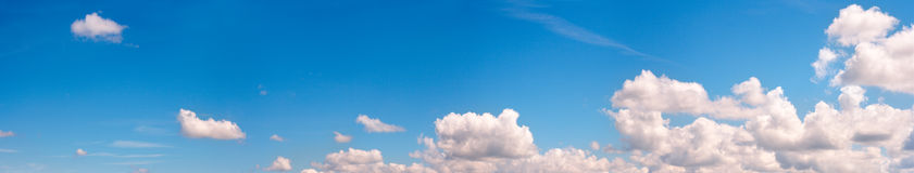 Blue sky panorama. Blue height sky above the forest with some clouds. Four shots stitch image Royalty Free Stock Photo