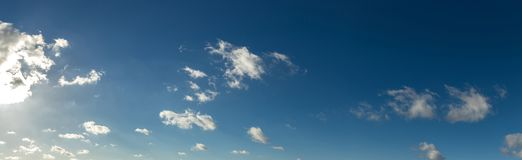 Blue sky panorama background with clouds Royalty Free Stock Images