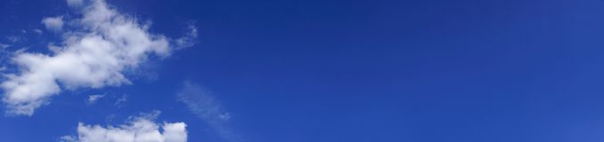 Blue sky panorama background with white clouds. Blue sky panorama background with some white clouds Royalty Free Stock Photo