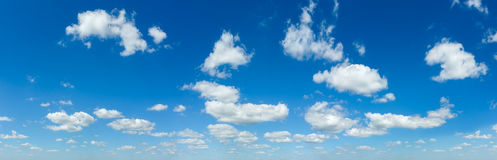 Blue sky panorama with white clouds. Blue sky panorama with white cumulus clouds (nature background Royalty Free Stock Image
