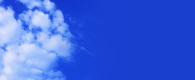 Blue sky panoramic. Wide panoramic background of Blue sky and white clouds Stock Photo