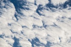 Blue  Sky with some white clouds. Blue Sky is partly filled with white clouds Royalty Free Stock Photo