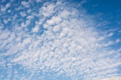 Blue  Sky with some white clouds. Blue Sky is partly filled with white clouds Stock Photography