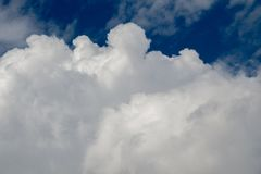 Blue  Sky with some white clouds. Blue Sky is partly filled with white clouds Royalty Free Stock Image