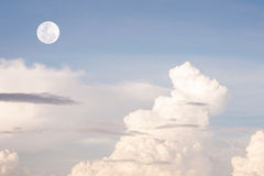 Blue sky with pattern of white cloud and the moon Royalty Free Stock Photos