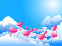 Blue sky with pink and yellow hearts Royalty Free Stock Image