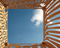 Blue sky and plywood with holes cut out Stock Image