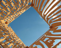 Blue sky and plywood with holes cut out Royalty Free Stock Image