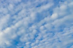 Blue sky and powdery clouds background royalty free stock photography
