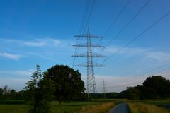 A blue sky and a power pole. And trees Royalty Free Stock Photos