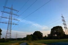 A blue sky and a power pole. And trees Royalty Free Stock Image