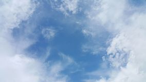 Blue sky and puffy cloud. Blue sky in the summer and puffy, light cloud Royalty Free Stock Image