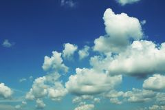 Blue sky with puffy clouds. Blue sky with a lot of white puffy clouds Stock Image