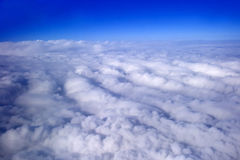 Blue sky and puffy clouds. On height of 5000 m above Earth Royalty Free Stock Photo