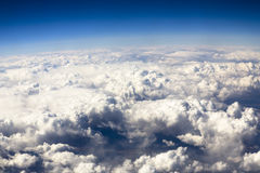 Blue sky and puffy clouds on height of 5000 m Stock Images