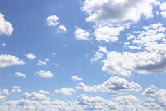 Blue Sky and puffy clouds. A horizontal shot of bright blue sky with puffy white clouds Royalty Free Stock Photography