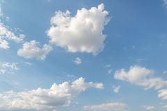 Blue Sky and puffy clouds Royalty Free Stock Image