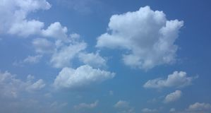 Blue sky, puffy clouds. A horizontal shot of bright blue sky with puffy white cloud formations Stock Photo