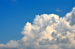 Blue sky with puffy clouds Royalty Free Stock Photo