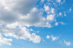 Blue Sky and puffy clouds. A shot of bright blue sky with puffy white and grey clouds Royalty Free Stock Photo