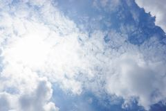 Deep blue sky with puffy clouds and sunlight. Blue sky with puffy clouds and sunlight Stock Photography