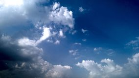 Blue Sky and puffy white & black clouds Stock Photo