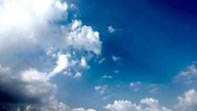 Blue Sky and puffy white & black clouds Royalty Free Stock Image