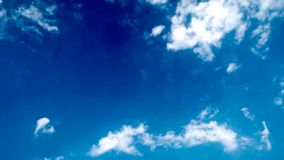 Blue Sky and puffy white & black clouds Royalty Free Stock Images