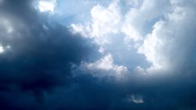 Blue Sky and puffy white & black clouds Stock Photos