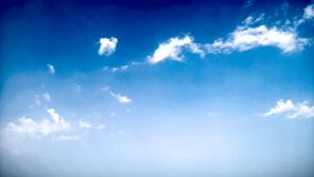 Blue Sky and puffy white & black clouds Royalty Free Stock Photos
