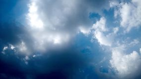 Blue Sky and puffy white & black clouds stock images
