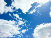Blue Sky with Puffy White Clouds Royalty Free Stock Image