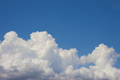 Blue sky with puffy white clouds bright clear sunny day Stock Image