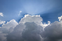 Blue sky with puffy white clouds in bright clear sunny day Royalty Free Stock Photo
