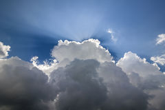 Blue sky with puffy white clouds in bright clear sunny day Stock Photos
