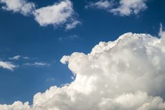 Blue sky with puffy white clouds in bright clear sunny day.  Stock Photo