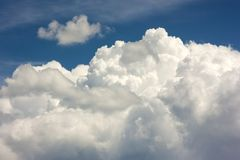 Blue sky with puffy white clouds in bright clear sunny day.  Royalty Free Stock Image