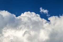 Blue sky with puffy white clouds in bright clear sunny day.  Royalty Free Stock Photography