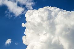 Blue sky with puffy white clouds in bright clear sunny day.  Stock Photography