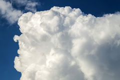 Blue sky with puffy white clouds in bright clear sunny day.  Royalty Free Stock Photos