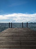 Blue sky and quiet deck by the sea in thailand. Royalty Free Stock Photo