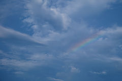 Blue sky. After rain, Rainbow on Stock Photography